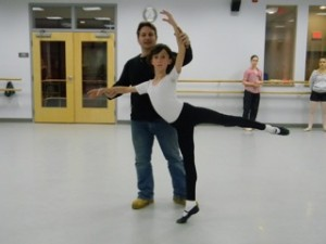 Tim Hartshorn works on his arabesque pose with Parren Ballard in preparation for the YAGP.